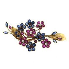 A 14k yellow gold flower brooch set with approximately 0.30ctw of VVS/FG diamonds along with Rubies and Sapphires. Crafted by Van Cleef & Arpels DESIGNER: Van Cleef & Arpels MATERIAL: 14K Gold GEMSTON