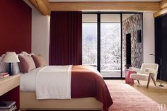 In the guest room, the designers used the same Loro Piana cashmere for the curtains, the coverlet, and the wall covering behind the bed; the rug is by Mansour Modern.