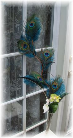 diy peacock centerpieces - See more vow renewal ideas at IDoStill.com