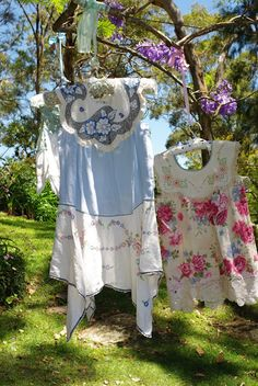 how sweet are these? tops or sundresses made from vintage aprons and embroidered lines.