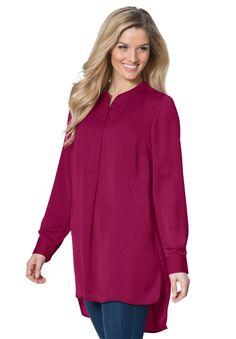 A modern tunic with a Mandarin collar with an asymmetrical hem has  all the…