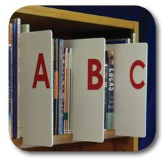 Information literacy and library skills products including shelf labeling, learning aids, media, plagiarism and more. Library Lesson Plans, Library Skills, Library Lessons, Library Ideas, Book Dividers, Shelf Dividers, Book Organization, Classroom Organization, Library Signage