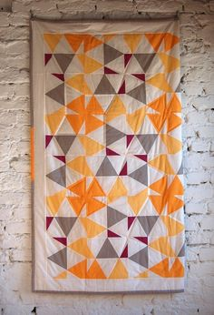 http://themodernquiltguild.com/2012/02/20/100-days-week-of-solids-featured-quilt-1/