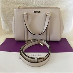 """Kate Spade Newbury Lane Loden Small ✨Brand New With Tag and Bag, Guarantee Authentic✨Also available in Black and pink•let me know if interested.  $165 + FREE SHIPPING on MERCARY or ️AY️AL•price is firm•  Size: Small•color: pebble Details: Satchel with snap closure and an adjustable, removable strap Dual interior slide pockets, two zipper, compartments, and interior zipper pocket Gold Kate Spade New York signature 8.2x10.9x4.7  drop length 4.3"""" handle  14 karat light gold hardware kate spade…"""