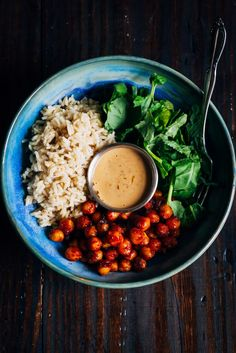 This vegan rice bowl is made with mouthwatering barbecue chickpeas, and paired with long-grain brown rice and a hummus vinaigrette.