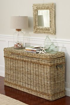 Tall wicker rattan trunk console that provides lots of storage and a rustic coastal beach chic natural look. Natural woven wicker such as rattan as well as seagrass make perfect furniture accent piece for coastal living. Featured on Completely Coastal. Coastal Homes, Coastal Living, Beach Homes, Coastal Cottage, Lake Cottage, Cottage Porch, Coastal Style, Coastal Decor, Seaside Decor