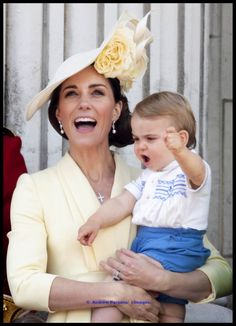 """Prince Louis joins Prince George and Princess Charlotte on the balcony of Buckingham Palace for the first time to watch the fly past at Trooping the Colour."