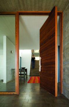 Big wood front door on pivot