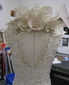 I love these! Artist Carrie Ann Schumacher creates these amazing dresses from the pages of books..... and a hole puncher! Love the creativity!