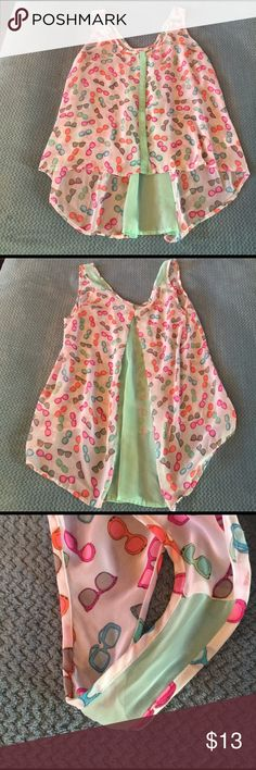 NWOT! Chiffon like Material Candies Hi Lo Tank! NWOT! Size L. Light weight and flowey Hi Low Tank! Sheer! Mint Green and multi color! Candie's Tops Tank Tops
