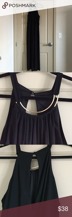 Brand New Black Halter Jumpsuit This beautiful never been worn black silky jumpsuit is so flattering for any figure. It has an eye-catching gold embellishment to give this out a little something something! Bisou Bisou Pants Jumpsuits & Rompers