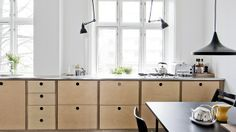 light wood with holes for pulls, bright white walls, black details