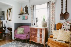 A favorite space, the eat-in kitchen, is full of character and more collected pieces. Vintage Mirror is from Century Vintage Charlotte. Dresser, wingback chair and accessories are from local thrift stores and the rug is West Elm.