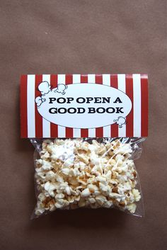 it is what it is: pop open a good book...This on a pack of microwave popcorn.