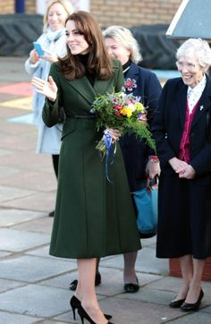 Visiting a primary school during her trip to Scotland, the Duchess of Cambridge kept warm in an emerald green Max Mara coat. <i>Photo: AP</i>