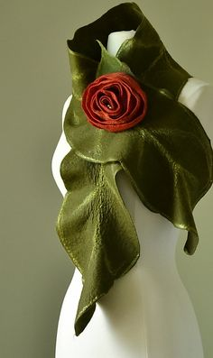 """""""Rebecca Scarf in Deep Green, Red Rose"""" Created by Elizabeth Rubidge One of a Kind 100% wool scarf with silk fiber accents has a softly draped leaf shape. Scarf is held in place with a hand felted and rolled scarlet rose pin."""