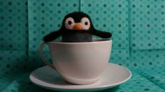 Needle felt penguin made and designed by Little Teacup.