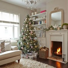 Need traditional living room decorating ideas? Take a look at this cream living room with Christmas tree from Ideal Home for inspiration. For more living room ideas, visit our living room galleries at Christmas Interiors, Christmas Living Rooms, Christmas Room, Noel Christmas, Christmas Fireplace, Christmas Photos, Xmas, White Christmas, French Christmas Tree