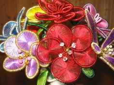 Ganutell is a Maltese art form of making artificial flowers from wire, thread, and beads.