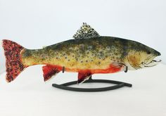 Fused Glass Brook Trout. This beautiful brook trout was made with multiple layers of hand cut art glass that adds not only brilliant color but depth and intrigue. The body of the fish is made of several layers of clear glass which provides a solid base structure. The glass is then embellished with opaque, translucent and iridescent fragments to create the look and texture that makes this piece of art truly unique. The fish measure approximately 18.5 x 7.25. French cleat system is adhered to…