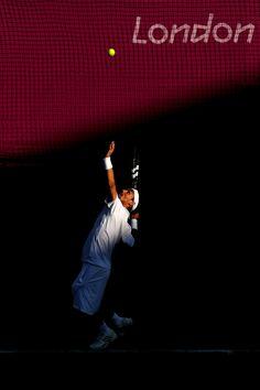 Fabio Fognini of Italy served during a singles match against Novak Djokovic of Serbia. Djokovic won, 6-7 (7-9) 6-2 6-2.