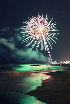 The reflection of the firework in the water is gorgeous. The colors seem almost unreal.