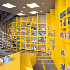 Unique bookcase design at the Vagabond Travel bookshop by Smansk design studio.