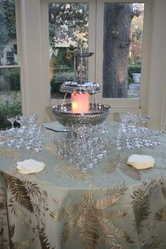 Champagne fountain with traditional champagne flutes from Confetti's Champagne Fountain, Champagne Tower, Champagne Flutes, Roaring 20s Party, 60th Birthday Party, Punch Recipes, Wedding Receptions, Beverage, Special Occasion