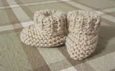 Super easy to knit baby booties!  I knit 12 rows of K1 P1 for the rolled cuff top