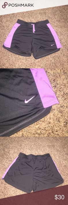 NIKE SHORTS!! PURPLE/DARK GREY!! Don't miss out on these super cute purple/dark grey Nike shorts!! They are stretchy and so comfy! They are size medium and 100% polyester! Asking $30/OBO! Feel free to message me questions or offers! It never hurts to send me an offer :) Nike Shorts
