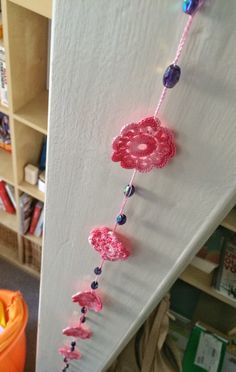 Rose shades long crochet pendant