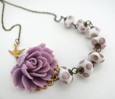 Lavender.... Asymmetrical Rose Necklace with Vintage Lampwork Glass Beads $29.00 #jewelry #necklace #glass #lavender #lilac #rose #mauve #swallow #bird #garden #thisle #amethyst #purple #periwinkle #vintage #glasswork #wisteria #sweet #gift #polka_dots #iris #acrylic #beads #brass