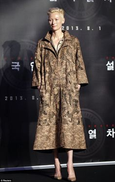 Sticking to her stye: Tilda Swinton stood out in a brown print coat at a press conference for Snowpiercer in Seoul on Monday