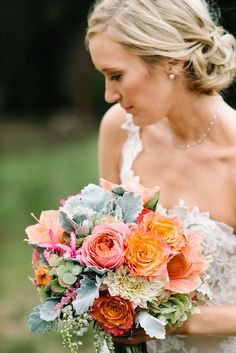Garden roses, hydrangea, pieris japonica, ranunculus, amaryllis and dusty miller = perfection ~ we ❤ this!
