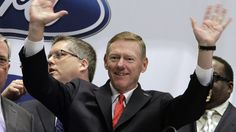 Alan Mulally, center, President and CEO of the Ford Motor Company, gestures as he prepares to ring the New York Stock Exchange opening bell, Tuesday, June 7, 2011.