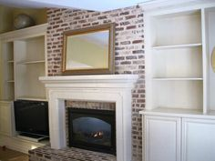 Bookcase Built In Bookshelves Around Fireplace | used stock cabinets from Home Depot, and had a contractor raise them ...