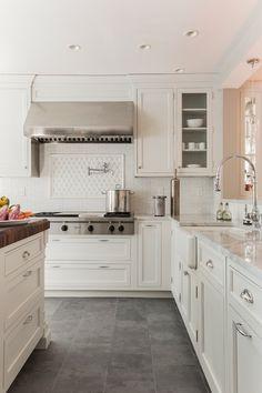 Creamy white cabinets paired with Supreme White Quartzite countertops | Venegas and Company