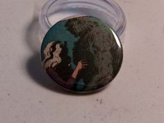 """Comic Book 1.5"""" Button// Swamp Thing and Abigail Arcane, $1.00"""