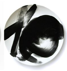Bringing her painter background to tabletop, Gail Garcia's eathernware dinner-ware line includes this striking black and white abstracted brushtroke design.