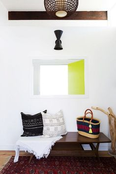 Bohemian inspired entryway with neon accents, and a bench
