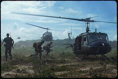 "UH-1D helicopters airlift members of the 2nd Battalion, 14th Infantry Regiment from the Filhol Rubber Plantation area to a new staging area, during Operation ""Wahiawa,"" a search and destroy mission conducted by the 25th Infantry Division, northeast of Cu Chi, Vietnam."