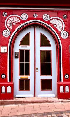 White and red stunning door in Fritzlar, Hesse, Germany.
