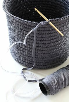 Crochet basket made with tape yarn over plastic tubing: