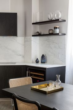 Westminster residential project by Studio Mills. White marble and black ash kitchen