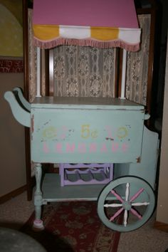 One of my favorite pieces. Believe it or not I sold it at Two Friends and Junk show in Joplin Mo, to an older women for her porch.This was a freebie, as it was not great wood and needed some repairs.   I had to fabricate a top on this.The parlor pink top was old wood awning,  I knew it had a purpose.The top are pieces from a shelf bracket. I painted the body seaside. The end has a cute little hutch, and the other side a money drawer.