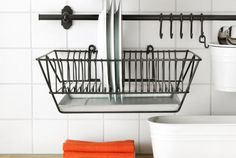Dry your dishes up high by hanging the dish drying rack on your backsplash. This tray even has a water collection tray underneath so your counter won't get wet.
