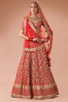 Red aari and zardozi lehenga with all over floral design by Sabyasachi