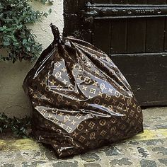 Luxury fashion brand wants to be more eco-friendly thus it created a new-fangled bin bag ;-)