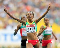 Meseret Defar of Ethiopia crosses the line to win gold in the women's 5000 metres