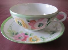 Teacup and Saucer Set Handpainted Floral Pastel Colors Made In Japan.